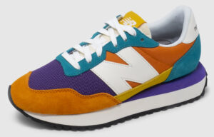 New Balance WS237 Women - vintage orange-purple